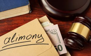 How do courts enforce alimony payments?