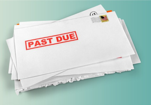 A stack of bills past due of an individual requiring the assistance of a bankruptcy lawyer in Washington IL