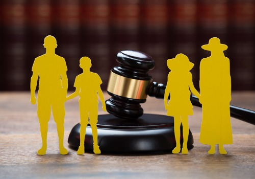 A gavel with a cut out family in front of it, representing a Family Law Attorney in Washington IL