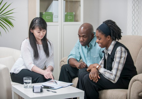 An attorney discussing Estate Planning in East Peoria IL with a married couple