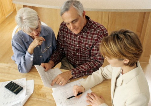 A lawyer talking with an elderly couple about Estate Planning in Pekin IL