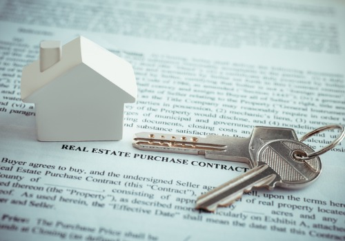 Keys and House on top of Contract for Real Estate Attorneys in Washington IL