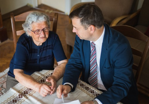 An attorney discussing Probate Law in Washington IL with an elderly client