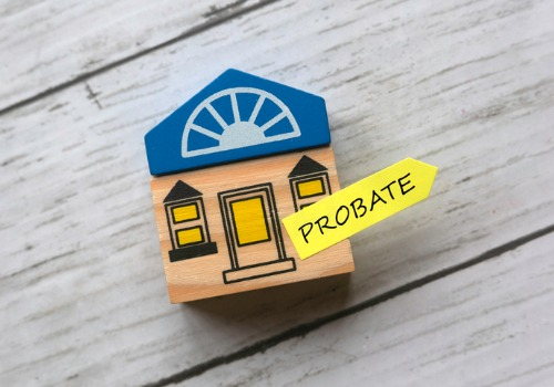Wooden House with Probate Sign on the Desk of a Probate Attorney in Washington IL