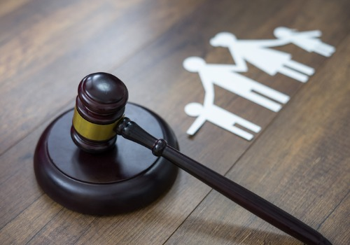 A gavel next to a cutout of a family, representing Family Law in Peoria IL