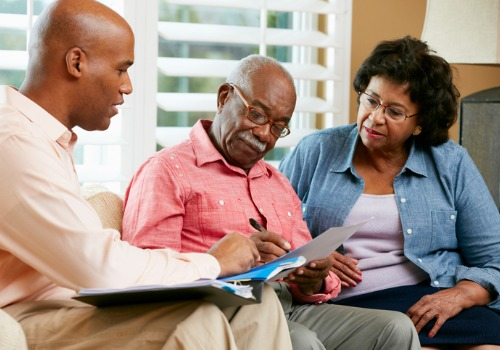 A senior couple talking with Estate Planning Attorneys in Eureka IL