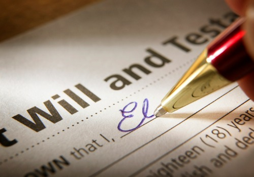 A will from Estate Planning Attorneys in Peoria IL being signed