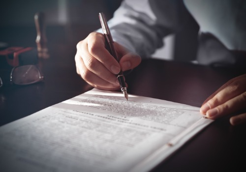 Estate Planning Attorneys in Morton IL filling out documents