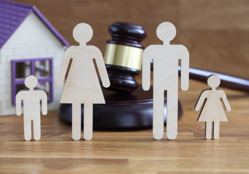 Wooden figures of a family in front of a gavel, representing Family Law in Morton IL