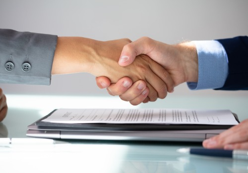 Closing Attorneys in Morton IL shaking hands over a real estate agreement