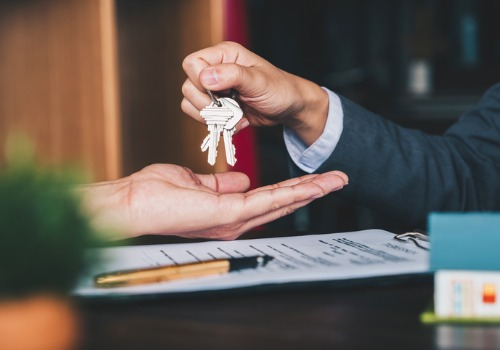 Closing Attorneys for Eureka IL handing keys to a new home owner