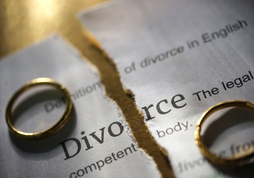 A ripped up document with two rings on it, representing a Contested Divorce Attorney in Washington IL
