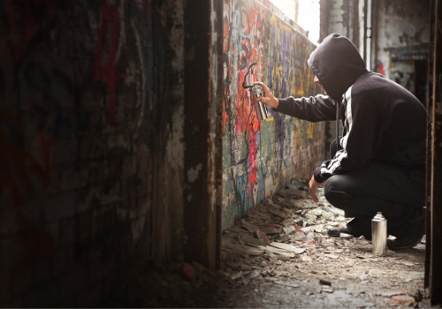 A teenager defacing a wall and violating Juvenile Law in Peoria IL