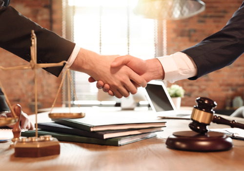 A DUI Attorney for Eureka IL shaking hands with a client