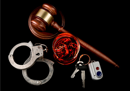 Handcuffs, keys, gavel and a drink, all related to a Felony DUI in Peoria IL
