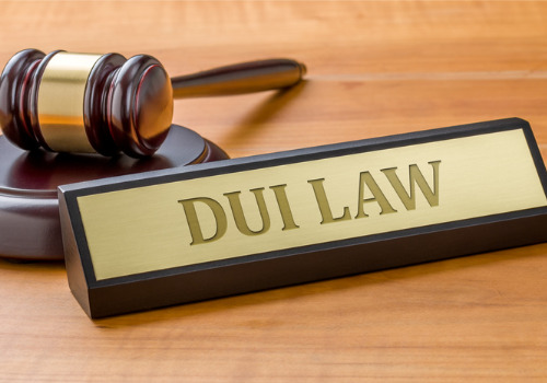 A name tag with DUI Law written on it, in front of a gavel
