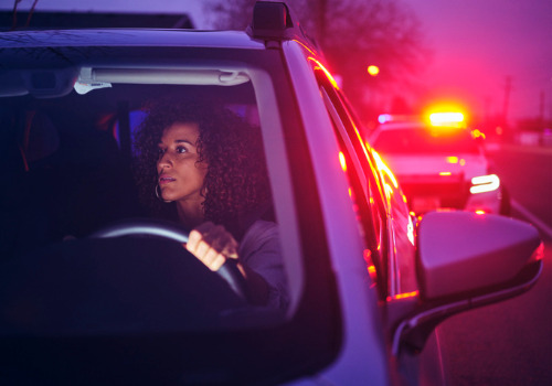 A driver being pulled over for a traffic violation, soon to need help from a Traffic Lawyer for Pekin IL