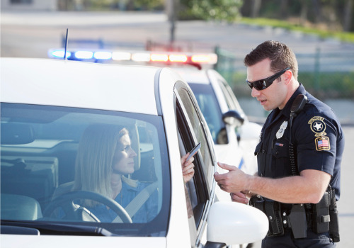 A woman being pulled over, soon needing help from a Traffic Lawyer in Morton IL